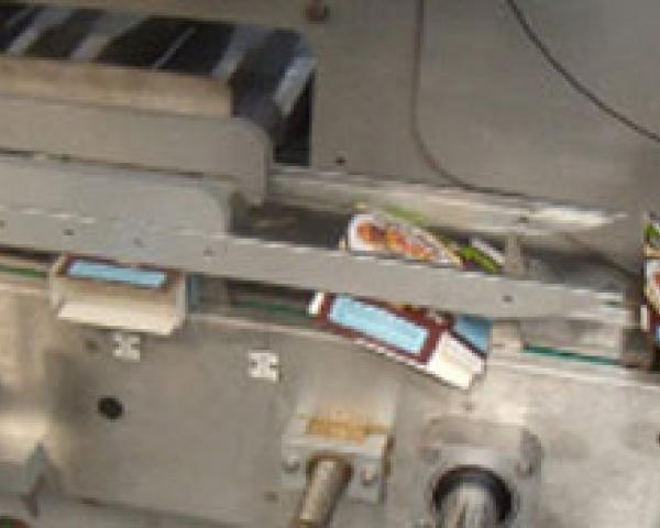 Оборудование, машина для упаковывания в картонную тару с боковой загрузкой компании Ixapack