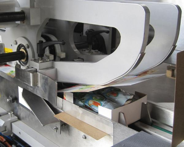 Оборудование, машина для упаковывания в картонную тару с вертикальной загрузкой компании Ixapack