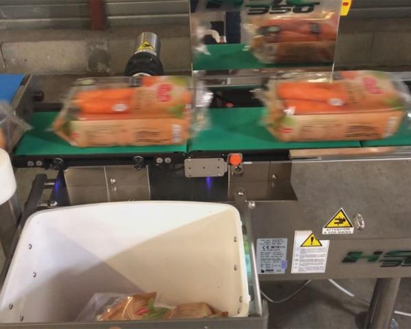Контроль веса в потоке упаковки моркови, готовое оборудование Украина